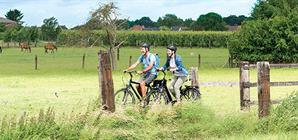 couple-cycling-in-the-countryside