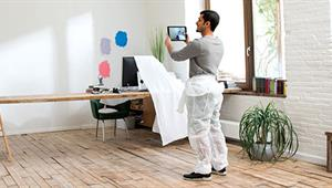 man-choosing-paint-for-wall-on-a-tablet